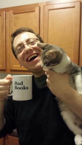 My friend's boyfriend sports his Duality of Man mug in one hand, and a cat in the other. (Items sold separately)